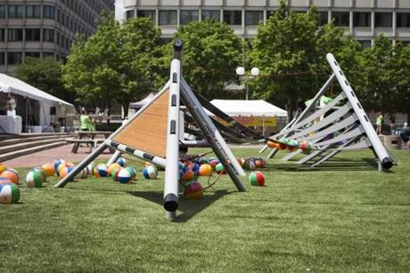 The City Hall playground includes semi-pyramidal structures with rubber treads.